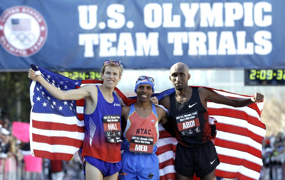 Ryan Hall, Meb Keflezighi, and Abdi Abdirahman celebrate after qualifying for the U.S. Olympic marathon team in Houston. (AP)