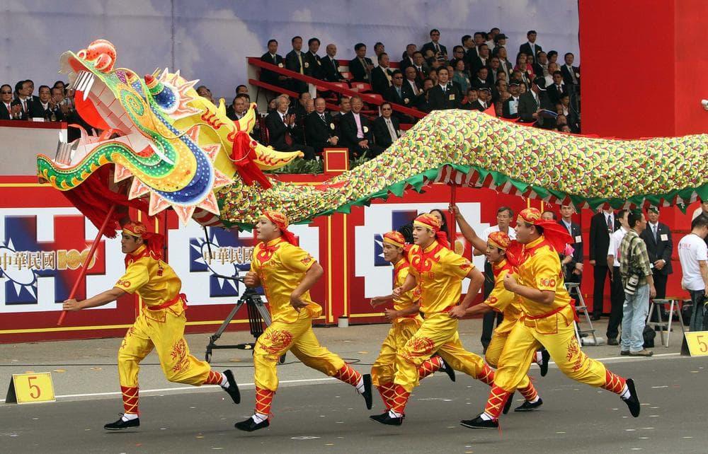Dragon dance performers in Taipei, Taiwan in October. (AP/Chiang Ying-ying)