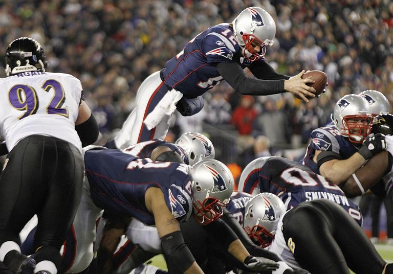 New England Patriots quarterback Tom Brady (12) dives over the middle to score on a one yard run against the Baltimore Ravens during the second half of the AFC Championship NFL football game  Sunday. (AP)