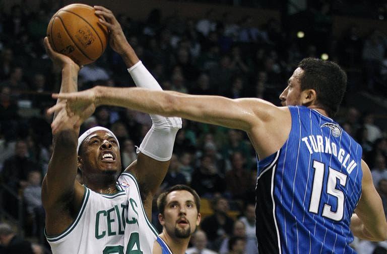Boston Celtics small forward Paul Pierce shoots as Orlando Magic forward Hedo Turkoglu reaches to block during the first quarter in Boston, Monday. (AP)