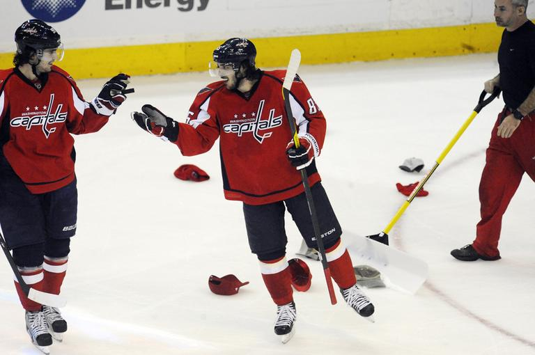 Washington Capitals' Mathieu Perreault, center, shakes hands with Marcus Johansson, of Sweden, after completing a hat trick against the Bruins during the third period Tuesday. (AP)