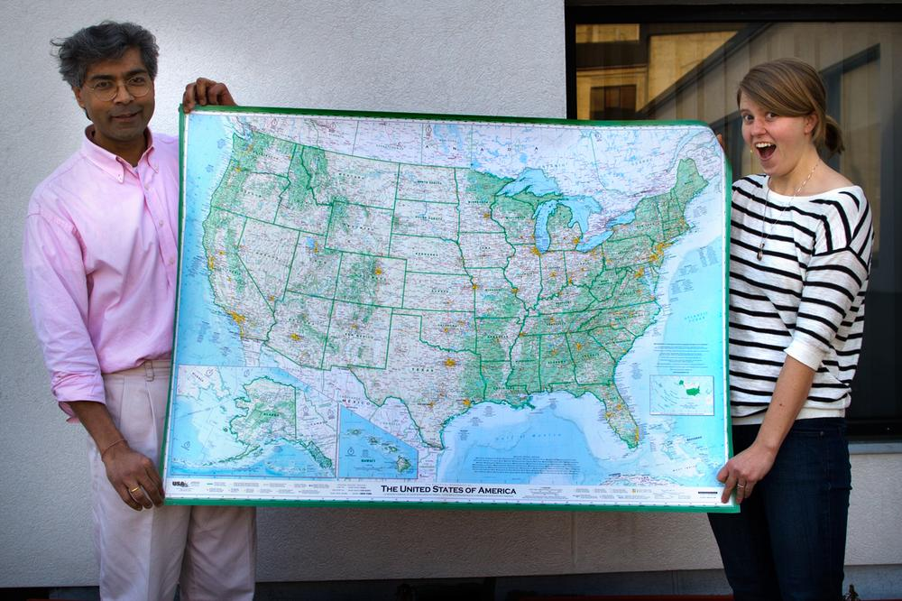 Here & Now producers Hitesh Hathi (left) and Jill Ryan hold Dave Imus' massive map of the United States. (Jesse Costa/Here & Now)