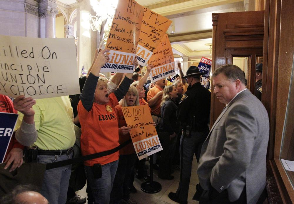 Rep. Scott Reske, D-Pendleton, stands outside of the House of Representatives during a debate on the right to work bill at the Statehouse Wednesday in Indianapolis. (AP)