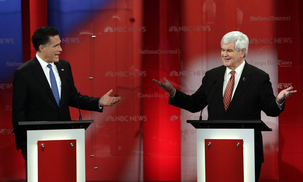 Republican presidential candidates former Massachusetts Gov. Mitt Romney, left, and former House Speaker Newt Gingrich gesture during a Republican presidential debate Monday in Florida. (AP)