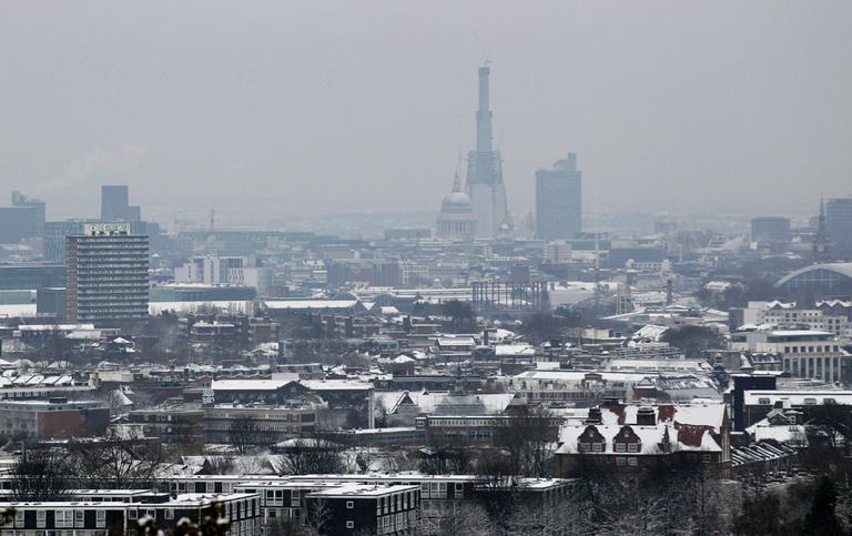 A view from Parliament Hill on Hampstead Heath shows the dome of St Paul's Cathedral standing dwarfed by the Shard building, which when construction is completed in 2012 will be the tallest building in the European Union. (AP)