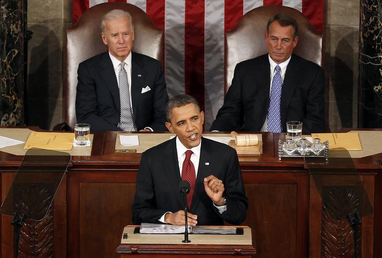 President Barack Obama gestures while giving his State of the Union address on Capitol Hill in Washington, Tuesday, Jan. 24, 2012. Vice President Joe Biden and House Speaker John Boehner of Ohio listen at rear. (AP)