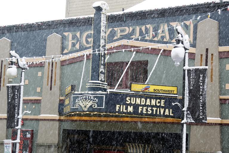 Snow falls on the Egyptian Theatre on Main Street during the 2012 Sundance Film Festival in Park City, Utah on Saturday, Jan. 21, 2012. (AP)