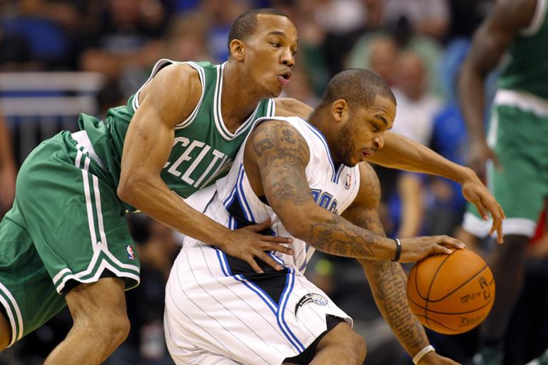 Orlando Magic's Jameer Nelson, right, drives past Boston Celtics' Avery Bradley during the first half of an NBA basketball game on Thursday, in Orlando, Fla. (AP)