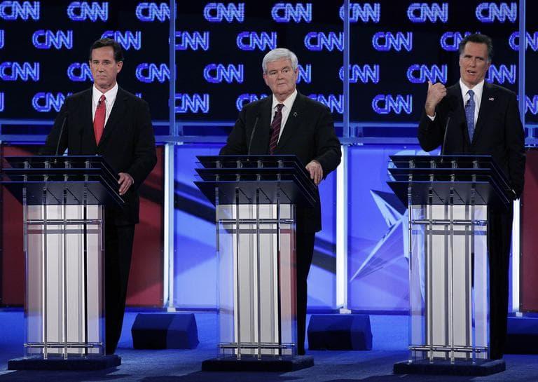 Republican presidential candidates, from left, former Pennsylvania Sen. Rick Santorum, former House Speaker Newt Gingrich and former Massachusetts Gov. Mitt Romney participate in the Republican presidential candidates debate in Jacksonville, Fla., Thursday. (AP)