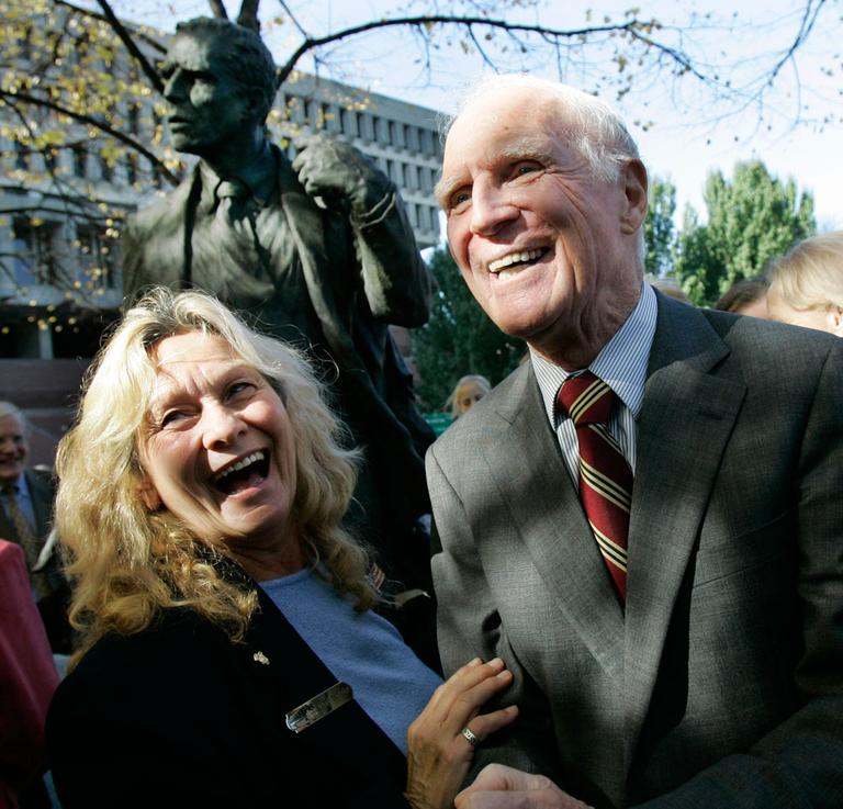 Former Mayor Kevin White laughs with supporter Marie Ostiguy after the unveiling of a statue bearing White's likeness outside Faneuil Hall on Nov. 1, 2006. (AP)