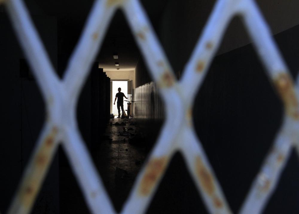 A man walks inside a prison in Tripoli, Libya. (AP)
