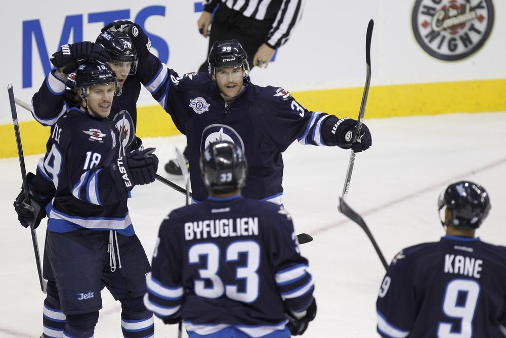 The Winnipeg Jets wouldn't make the playoffs if the postseason started today, but Helene Elliott says having them back in the league is a win for the NHL. (AP)