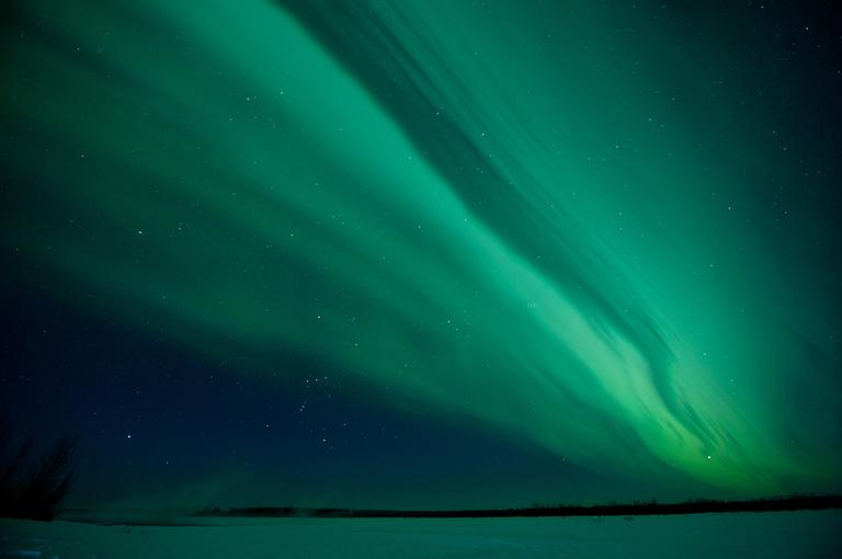In this photo taken Monday, Jan. 23, 2012, the skies over the frozen Susitna River near Talkeetna, Alaska are lit up by a display of the northern lights, or Aurora Borealis. A common occurrence in northern climates, the aurora was enhanced in this display by solar flares in the days preceding the event. (AP)