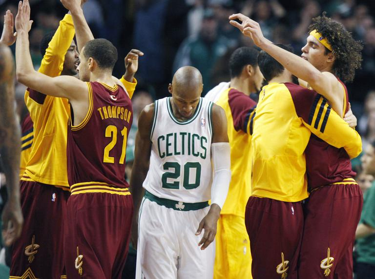 Boston Celtics' Ray Allen heads off the court as the Cleveland Cavaliers Anderson Varejao, right, and Mychel Thompson celebrate the Cavaliers' 88-87 win in Boston, Sunday. (AP)