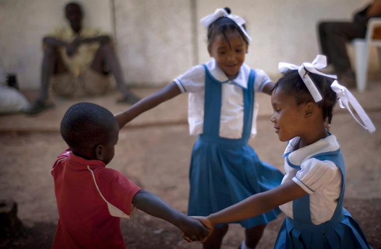 In this photo taken on Jan. 17, Soraya, 5, right, and her sister Leila Laurentus, 6, center, play with a friend in Calebasse, on the outskirts of Port-au-Prince, Haiti. The sisters were among 33 children who U.S. missionaries tried to take out of Haiti after the Jan. 12, 2010 earthquake and were reunited with their parents in March 2010. (AP)