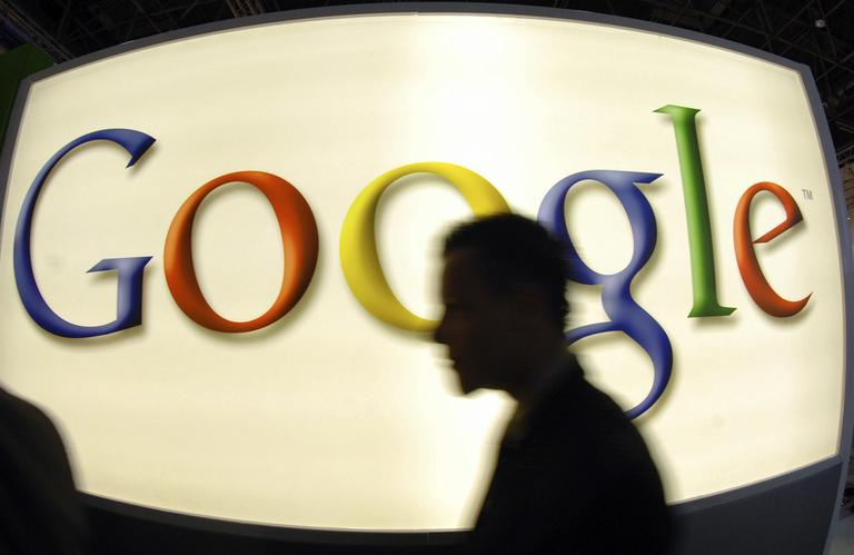In this Sept. 25, 2007 file picture a visitor passes an exhibition stand of Google company in Duesseldorf, western Germany. German prosecutors have launched an investigation of Google Inc. in connection with a privacy breach that involved it recording fragments of people's online activities through unsecured Wi-Fi networks. (AP)