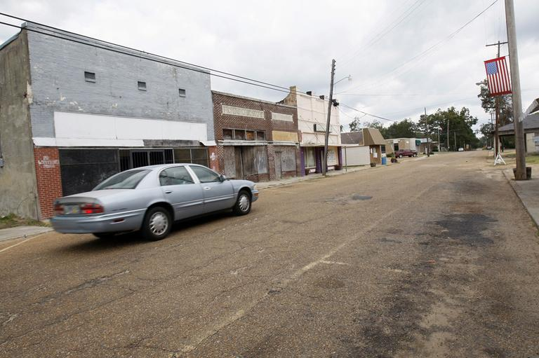 In this Oct 19, 2011 file photo, an automobile rolls past many closed storefront businesses in downtown Pickens, Miss. The ranks of America's poor have climbed to a record high, according to new census data that paints a stark portrait of the nation's haves and have-nots at a time when unemployment remains persistently high. (AP)
