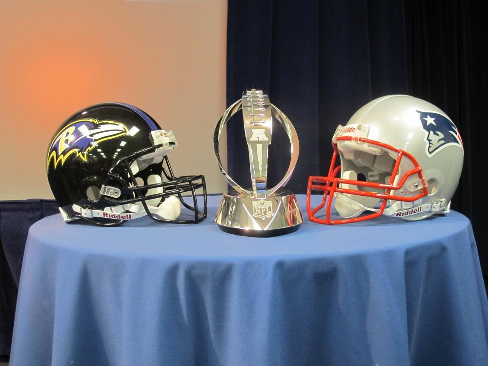 The new Lamar Hunt trophy, flanked by helmets of the two teams in January's AFC Championship Game. (Doug Tribou/Only A Game)