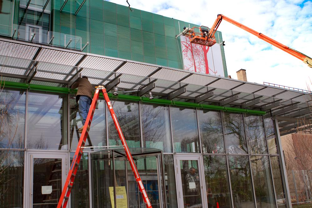 The facade of the museum's new building is worked on. (Jesse Costa/WBUR)