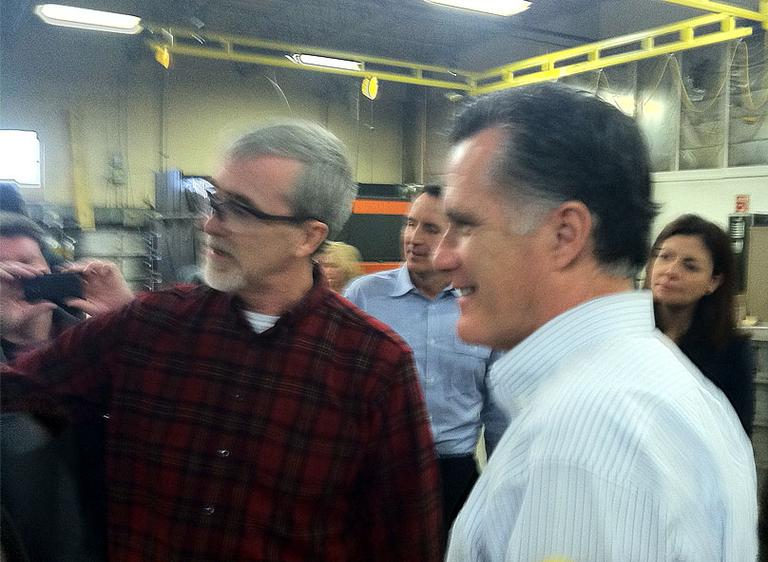 Mitt Romney tours a metal fabricating facility in Hudson, N.H., Monday (Deborah Becker/WBUR)