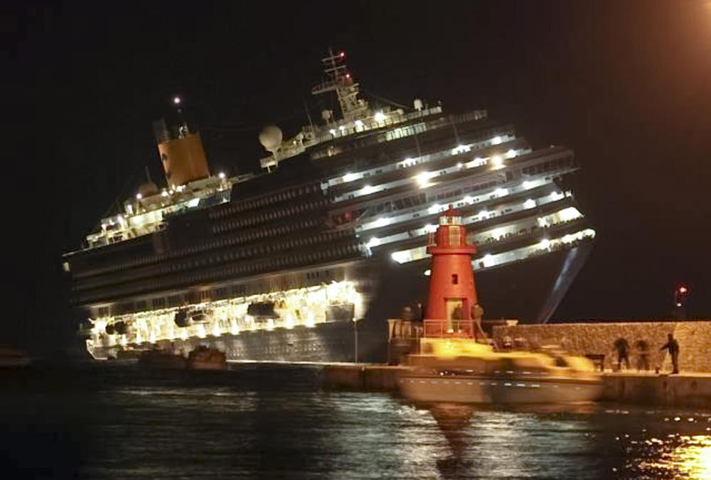 The luxury cruise ship Costa Concordia leans after it ran aground off the coast of Isola del Giglio island, Italy, gashing open the hull. (AP)