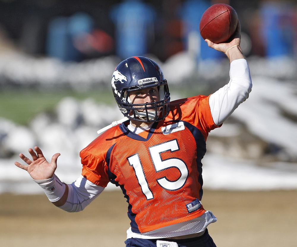 Tim Tebow throws a pass during practice at the football team's training facility in Englewood, Colo., on Tuesday. (AP)