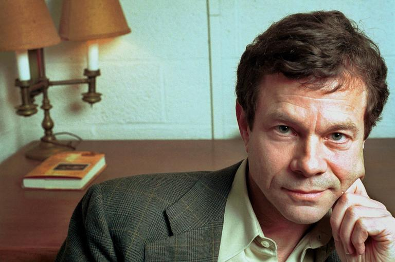 Alan Lightman sits in his office at the Massachusetts Institute of Technology in 2000. (AP)