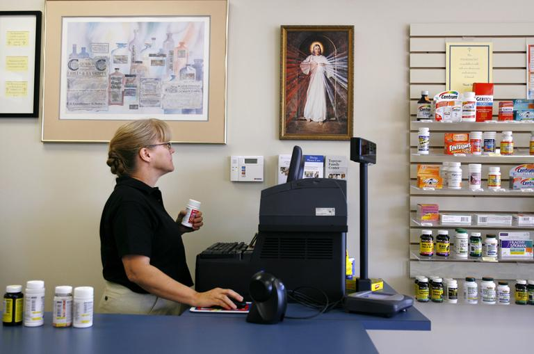 """Pam Semler, of Fairfax, Va., works the register at DMC Pharmacy in Chantilly, Va. on Monday, Oct. 20, 2008. The pharmacy bills itself as """"pro-life"""" and carries no contraceptive products. (AP)"""