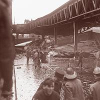 "Wreckage under elevated train tracks from the molasses disaster (Courtesy of ""The Great Molasses Flood,"" by  Deborah Kops)"