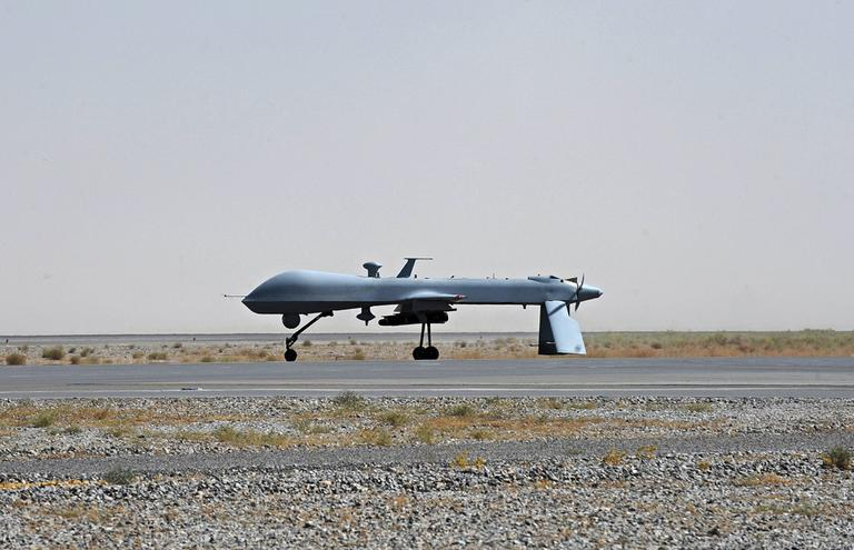 A U.S. Predator unmanned drone armed with a missile stands in Afghanistan in June 2010. (AP)