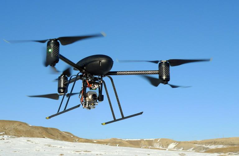 A small Draganflyer X6 drone is photographed in January 2009 during a test flight in Mesa County, Colo., with a Forward Looking Infer Red payload. (AP)