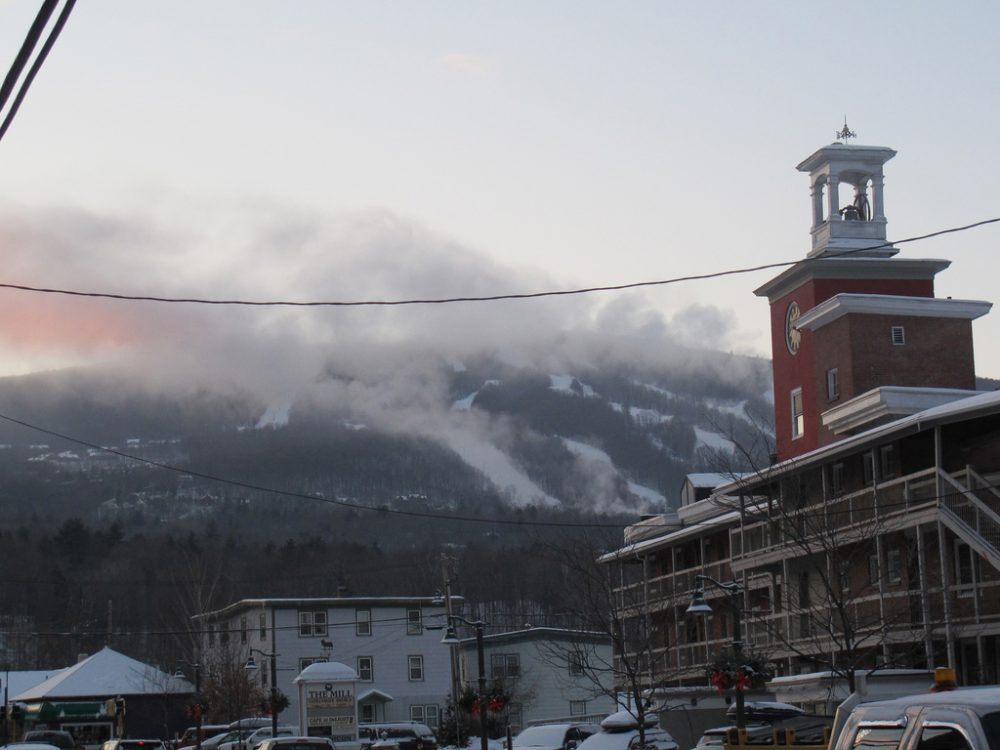 An old mill on Main Street in Ludlow now houses condominiums. Just in the distance, is the town's modern-day economic engine: Okemo Mountain Resort. (Doug Tribou/Only A Game)