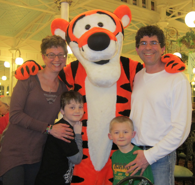Marie Colantoni Pechet with her husband, sons and Tigger.