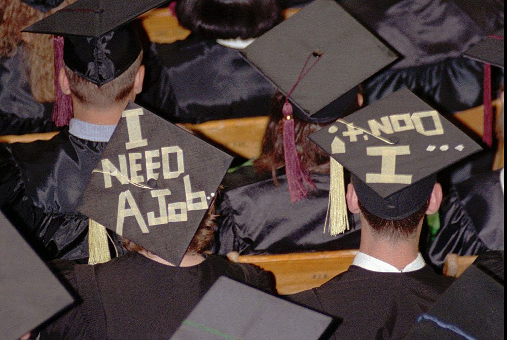 College graduates (AP Photo/Mark Hall)