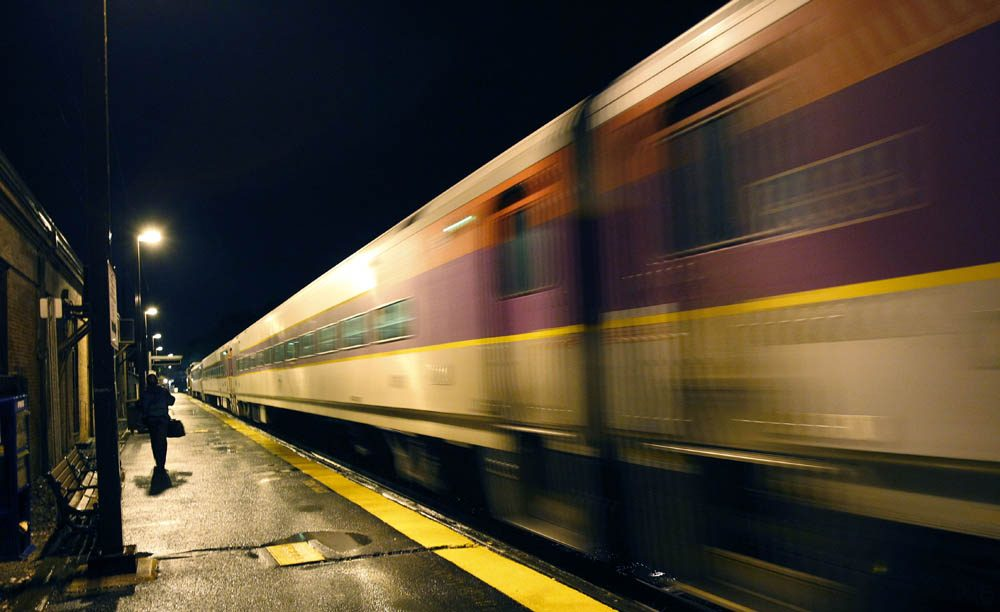 In this photo taken May 24, 2011, a commuter train leaves the MBTA station in Andover, Mass. (AP)