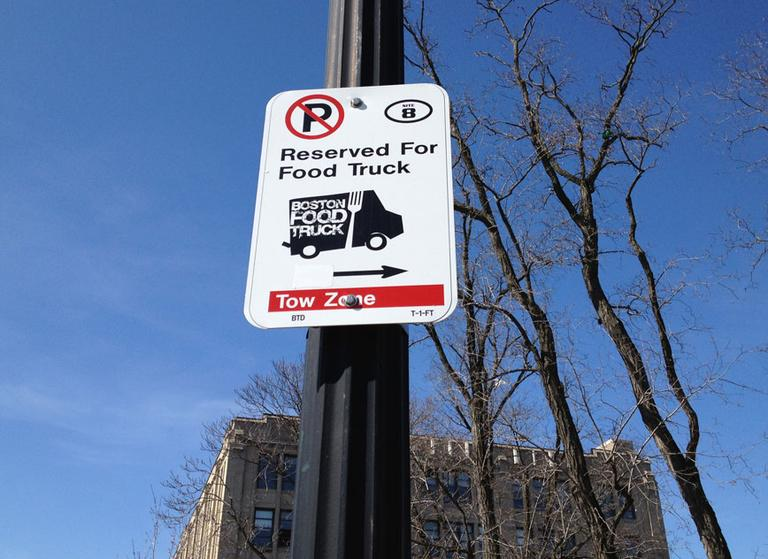 A sign marks a reserved food truck space on Commonwealth Avenue. (Adam Ragusea/WBUR)
