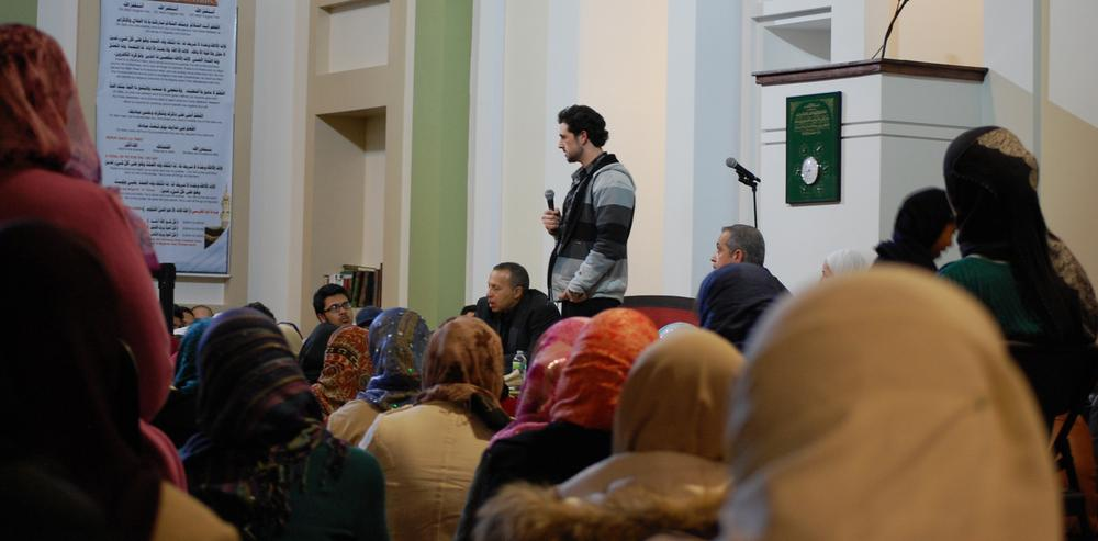 Syrian activist Danny Abdul Dayem, speaking at the Islamic Society of Boston Cultural Center in Boston. (Jill Ryan/Here & Now)
