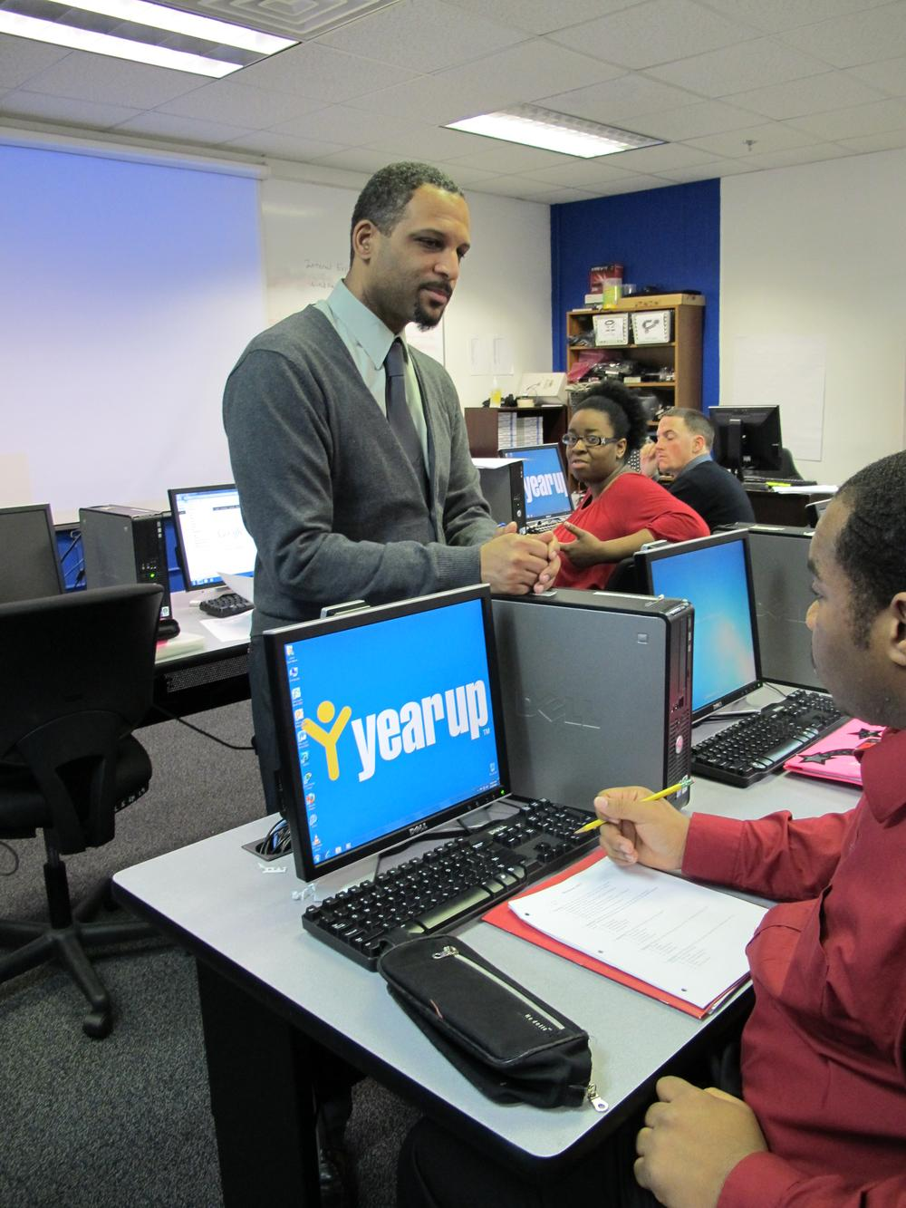 Peter Bos teaching a computer basics class at Year Up Boston. (Monica Brady-Myerov/WBUR)