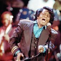 "Gospel-soul singer James Brown sings ""Living in America"" during his three-hour concert at the Wiltern Theater in Los Angeles, Ca., on June 10, 1991. (AP)"