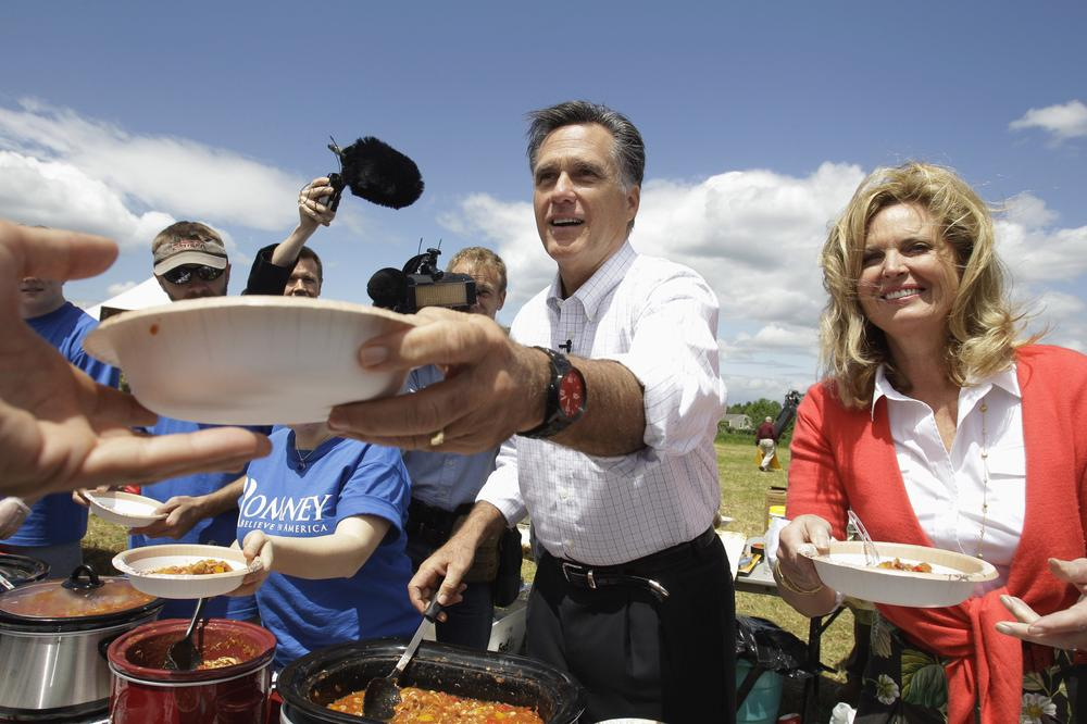 "Mitt and Ann Romney serve ""Ann Romney's famous chili"" at a New Hampshire campaign event in June 2011. Mormon cuisine and the church practice of storing a three month supply of food are gaining attention as Romney runs for president. (AP)"