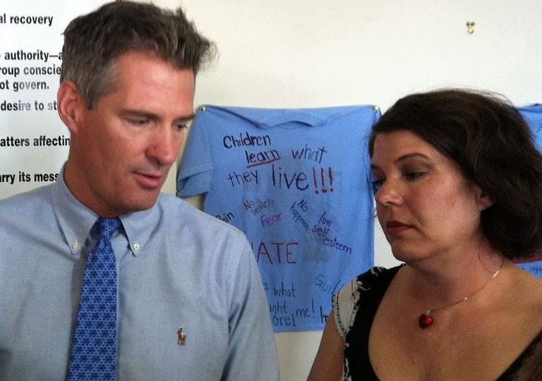 Sen. Scott Brown and his younger sister, Lee Ann Riley, speak to reporters about growing up with abusive stepfathers. (Fred Thys/WBUR)