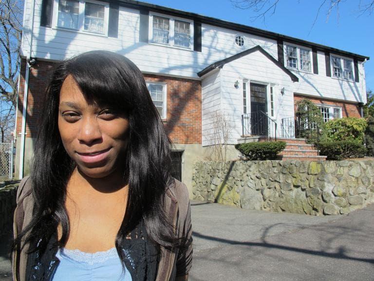 Playwright Kirsten Greenidge in front of her childhood home in Arlington. (Andrea Shea/WBUR)