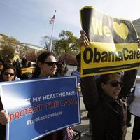 Supporters of health care reform rally in front of the Supreme Court in Washington, Wednesday (AP)