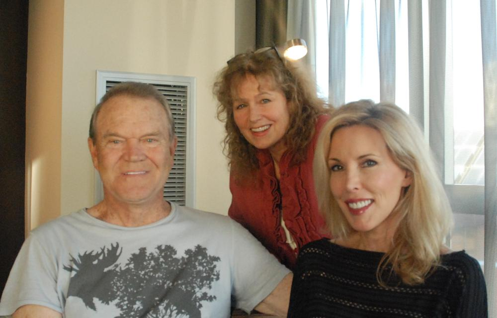 Here & Now's Robin Young (center) visited with Glen Campbell and his wife Kim on the day of his recent show at The Wilbur Theater in Boston. (Alex Ashlock/Here & Now)