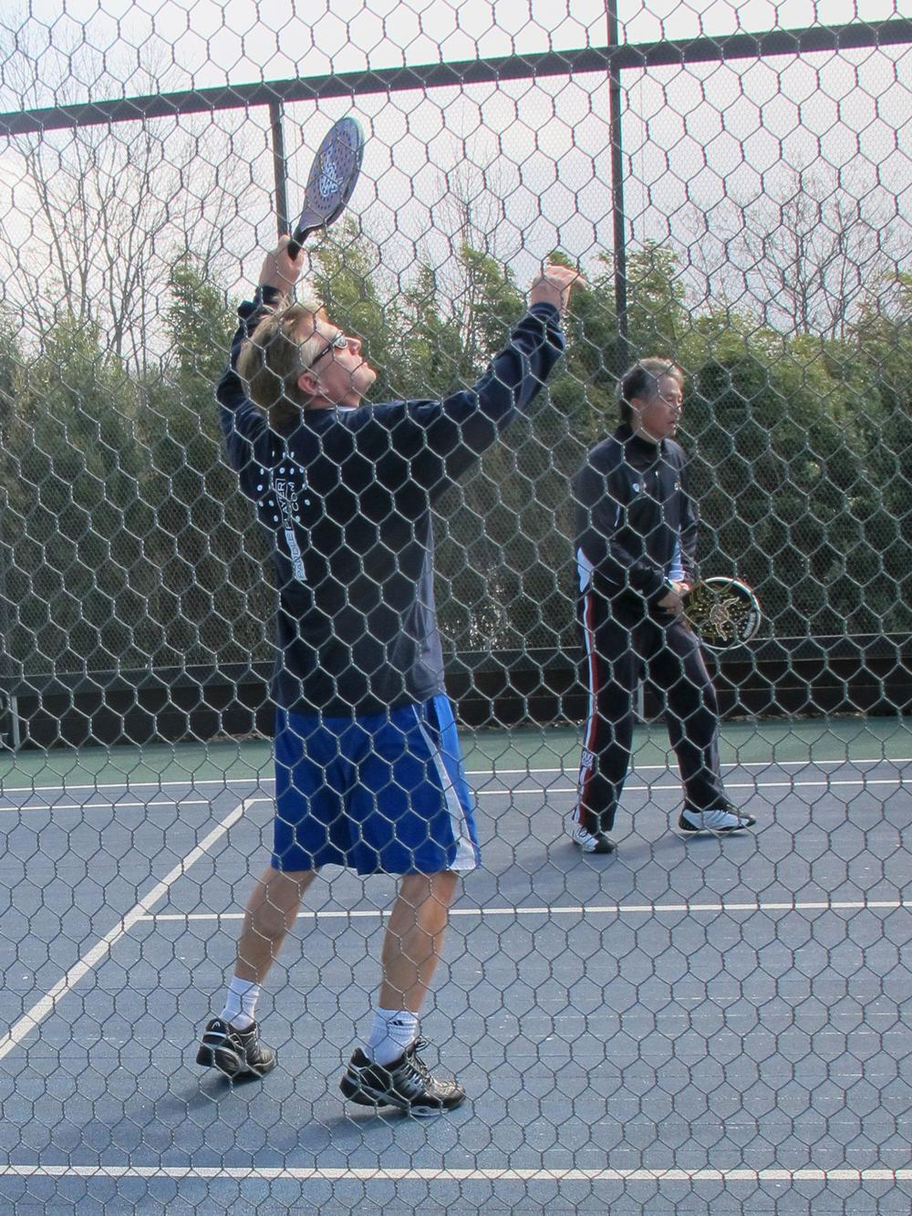 Smaller courts and the ability to play the ball off the cage make for long rallies. (Doug Tribou/Only A Game)