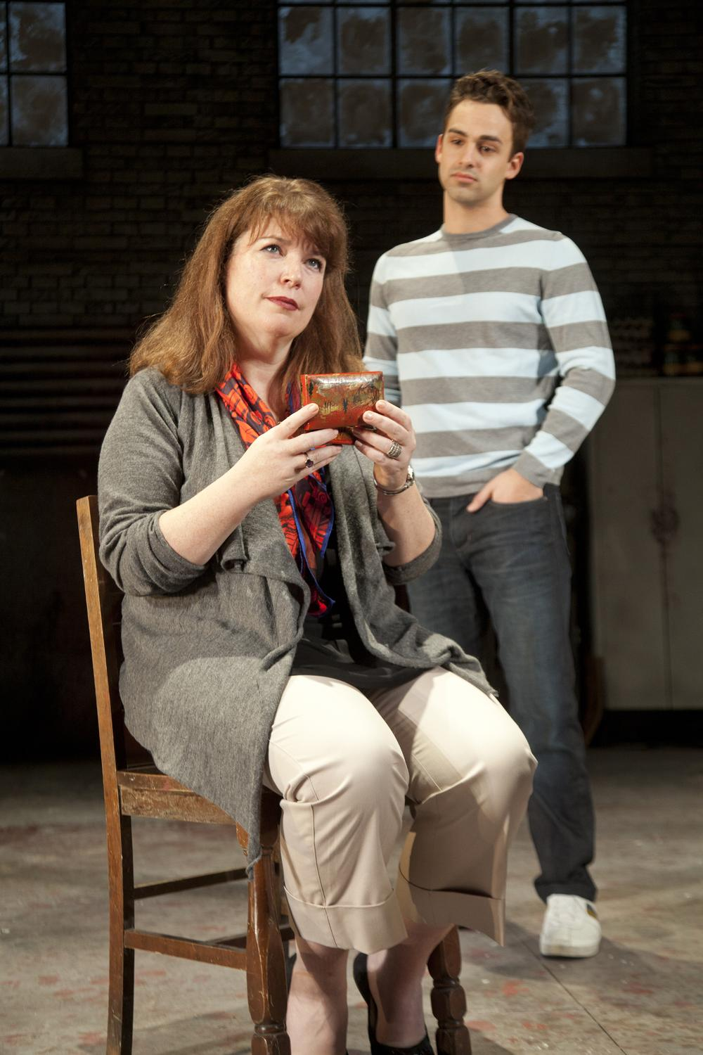 A music box brings back some painful memories for a mother and son (Kerry A. Dowling and Michael Tacconi) in a scene from Next to Normal  (Saglio Photography Inc.)