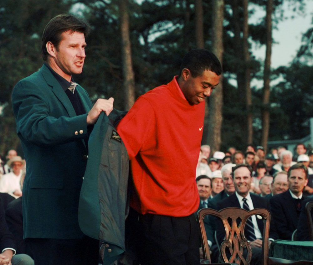 Tiger Woods won his first major championship after a record-breaking performance at the 1997 Masters. Some observers consider it the defining win of his career. (AP)