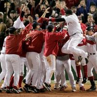Boston Red Sox David Ortiz leaps into the waiting arms of his teammates as they celebrate his 12th inning game winning homer against the New York Yankees at Boston's Fenway Park in game four of the ALCS, Sunday Oct. 17, 2004. The Red Sox won, 6-4. (AP)