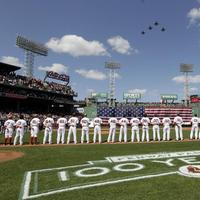 Sox players line up for the national anthem as fighter jets from the Vermont National Guard fly over Fenway, April 13. (AP)
