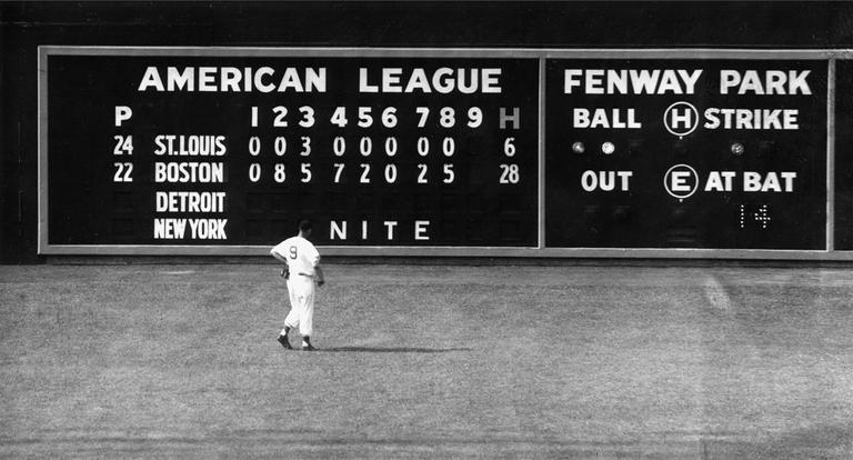 In this June 8, 1950, file photo, Sox left fielder Ted Williams views the scoreboard at Fenway Park. (AP)